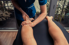 stock-photo-46624300-woman-getting-leg-massage